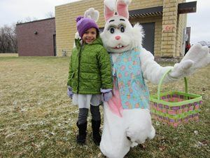 Easter Bunny and little girl at Easter Egg Hunt.